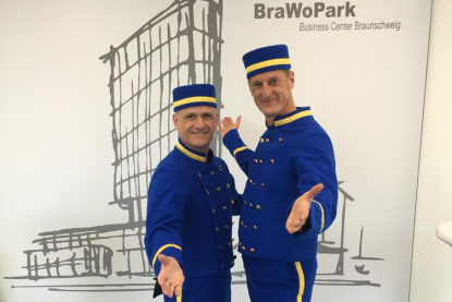 Liftboys in blue costumes in Braunschweig